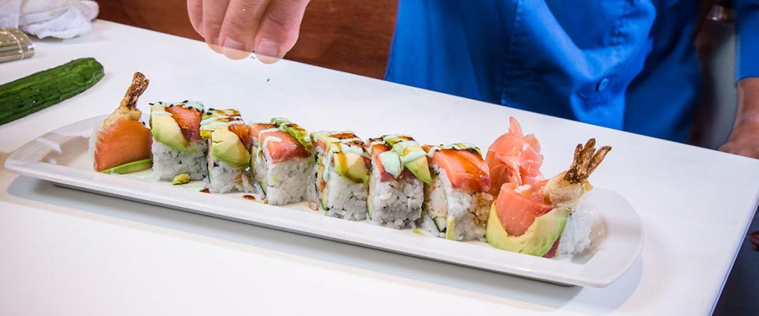 Chef preparing sushi rolls