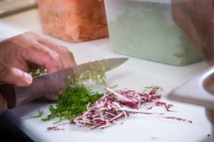 A Chef Chopping Fresh Ingredients